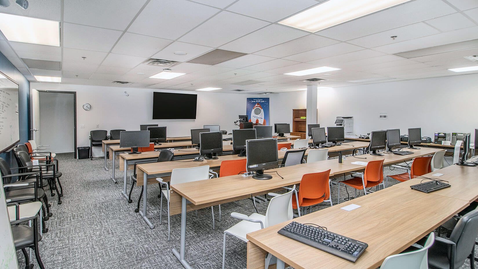 Classroom with row tables and computers