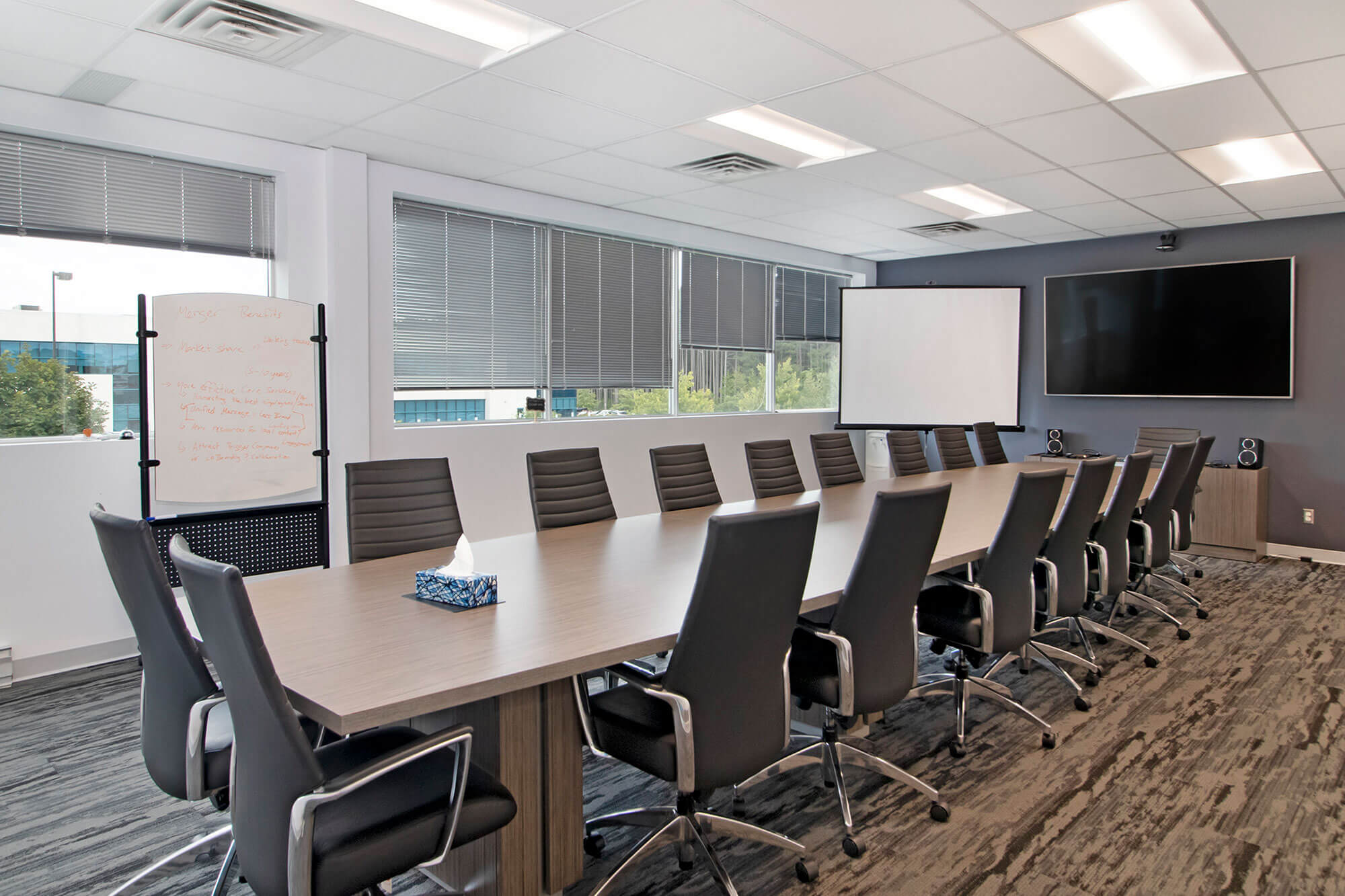 conference room with long table and tv