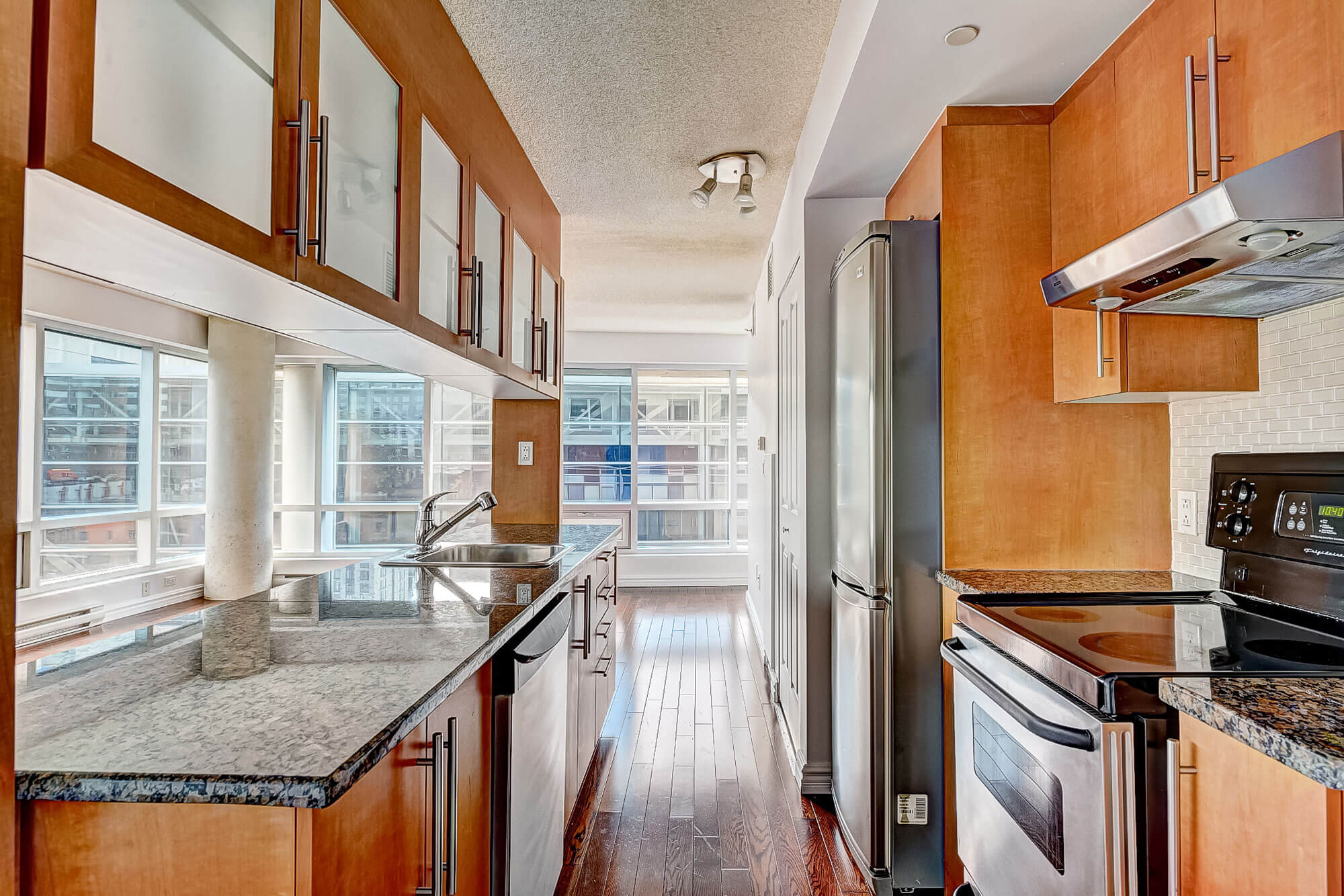 residential unstaged modern kitchen and area