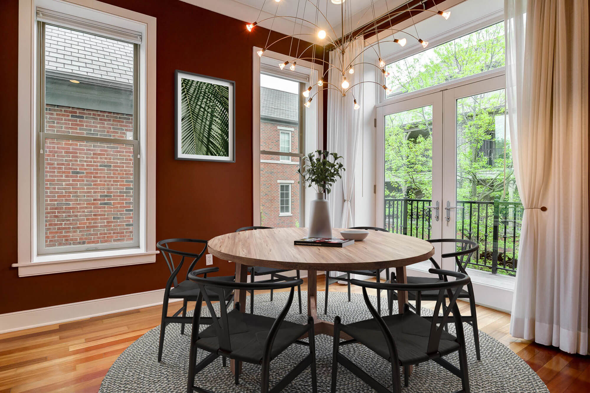 residential staged dining area with large windows