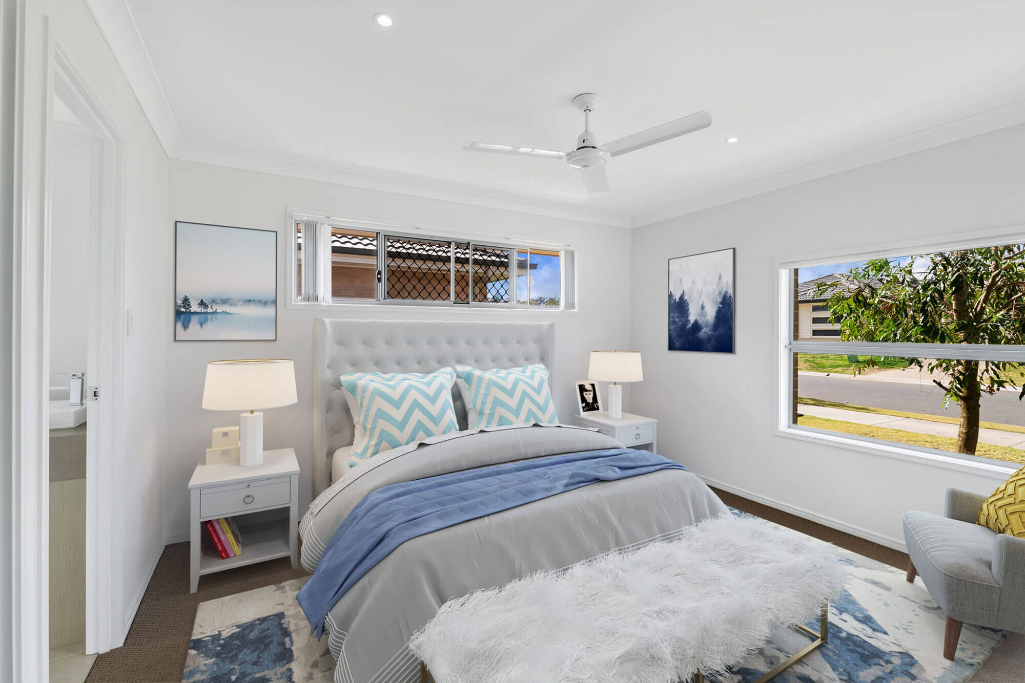 staged bedroom with blue and grey tones